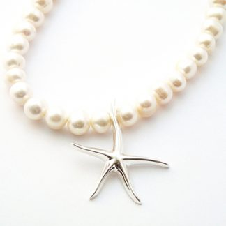 Cream freshwater pearls with a Starfish pendant